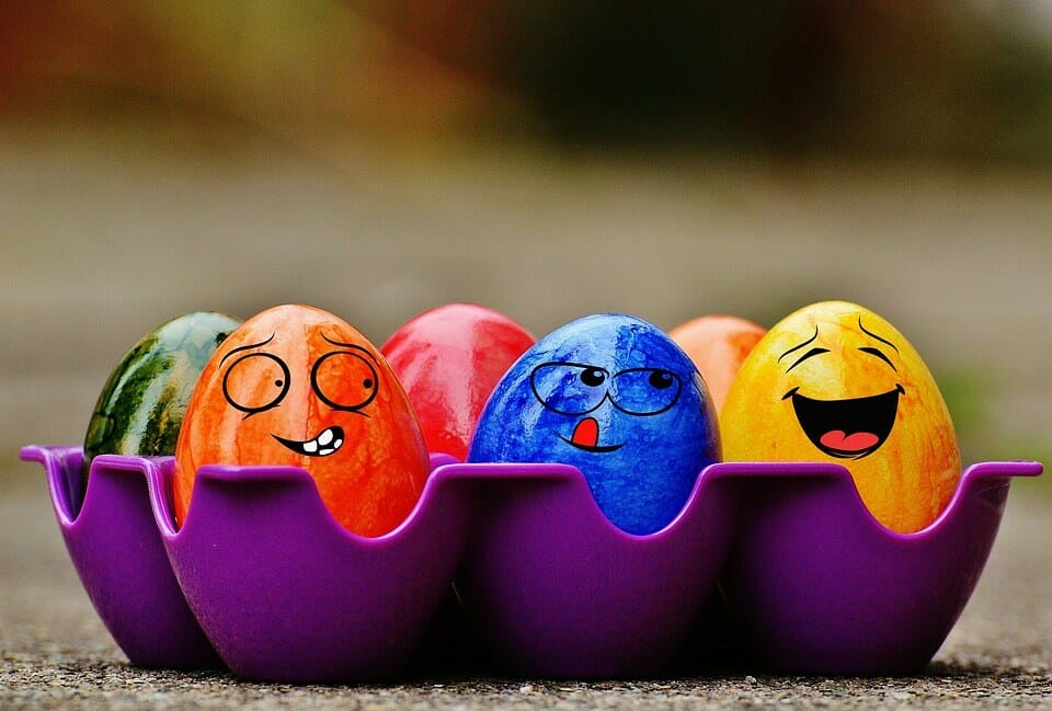 Painted colorful eggs with faces