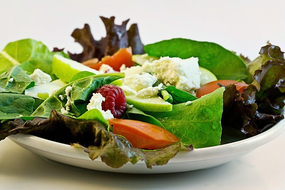 Feta and goat's cheese, a few berries, and mixed greens make for a fresh and healthy salad.