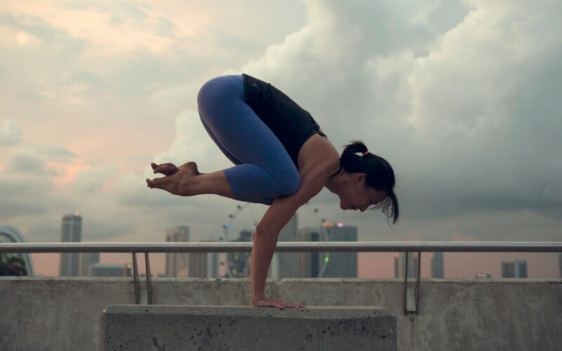 Woman doing balance training on the balcony