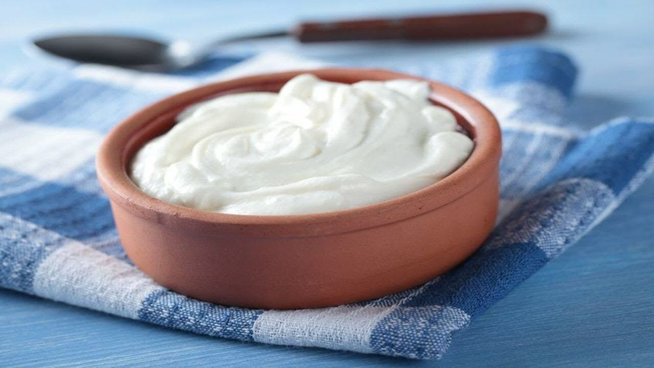 Greek yogurt in a clay bowl