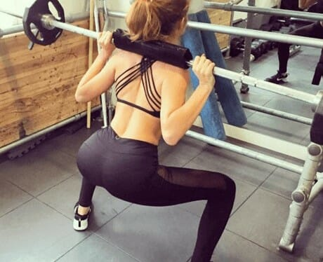 Attractive woman doing squats