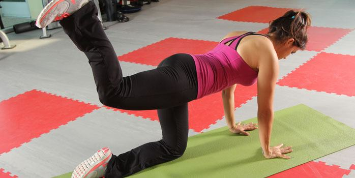 Woman doing hip extension workout