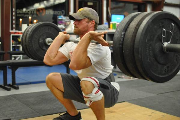 Man performing front squat