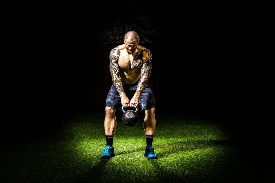 Man doing kettlebell workout