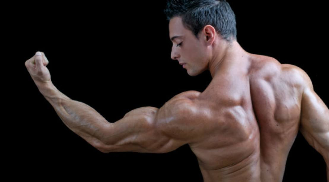 Man looking at his biceps