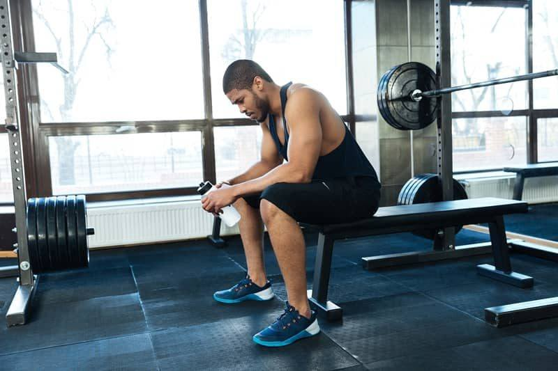 Man resting at a gym