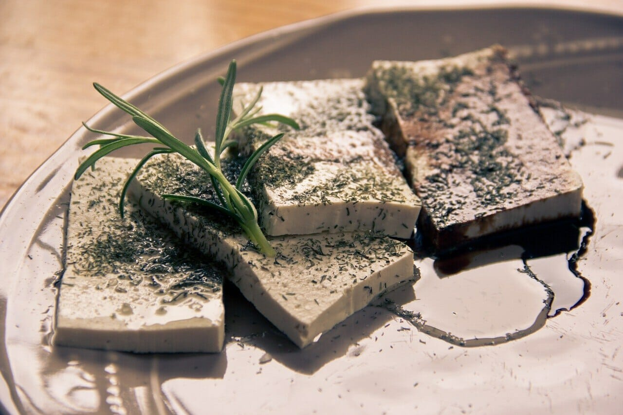 Tofu and olive oil dish on a plate