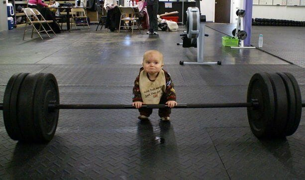 Baby in a gym doing deadlift