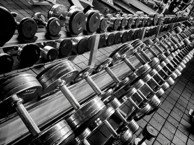 Black and white photo of dumbbells in a gym