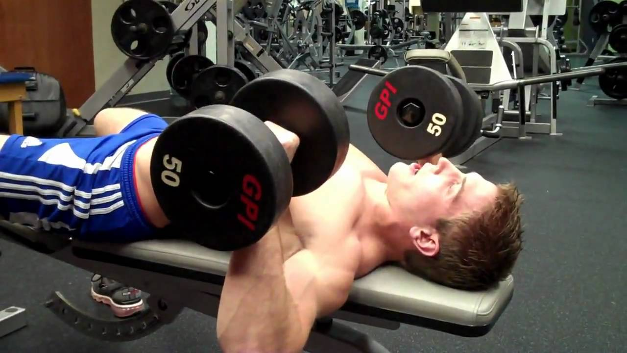 Man doing dumbell chest workout