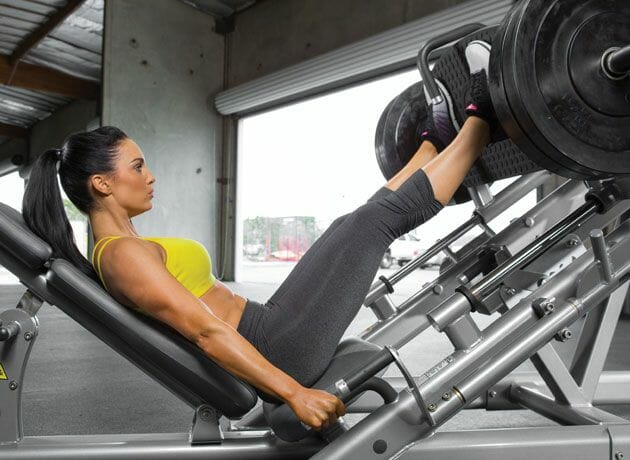 Woman doing leg press workout