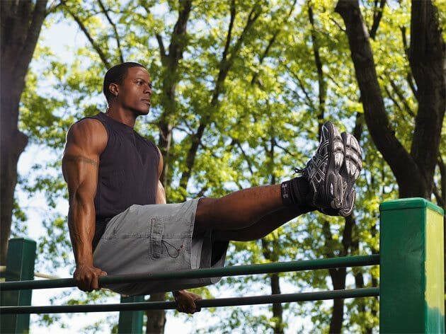 Man doing bodyweight exercises in a park