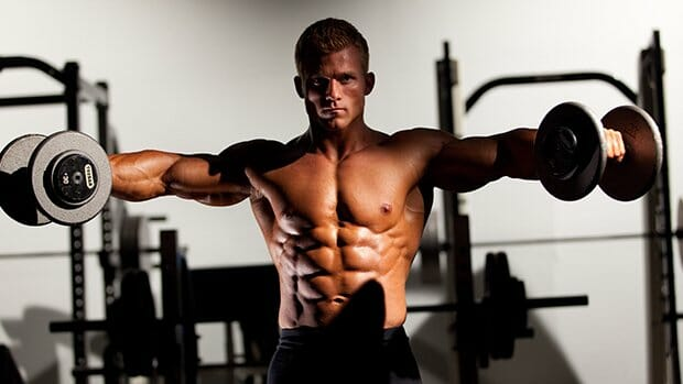 Man doing lateral raises workout - Shoulder Muscles