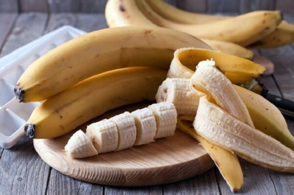 Whole and sliced bananas on board