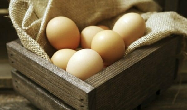 Eggs in a rustic wooden crate
