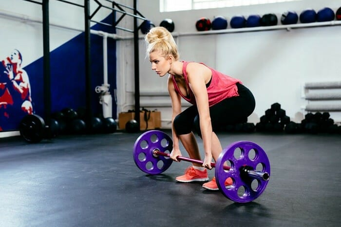 Woman performing deadlifts
