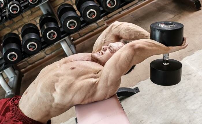 Man doing dumbbell pullover exercise