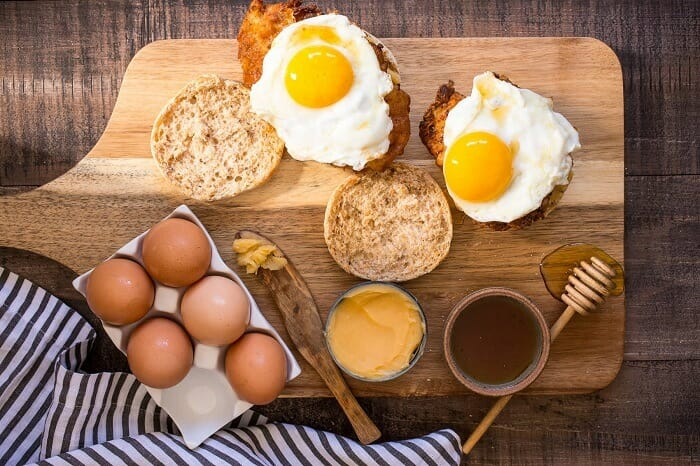 Eggs, bread and honey for nutritious breakfast