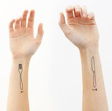 Fork and spoon tatoo on arms