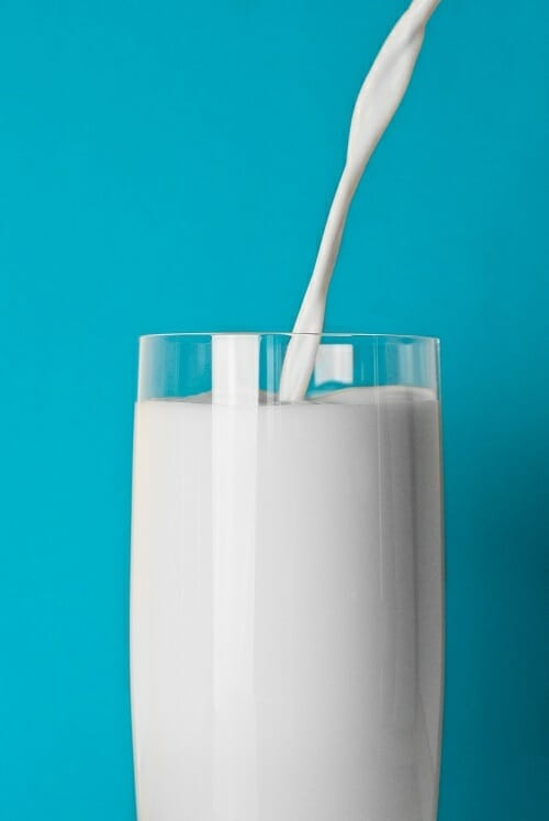Glass of milk on a blue background