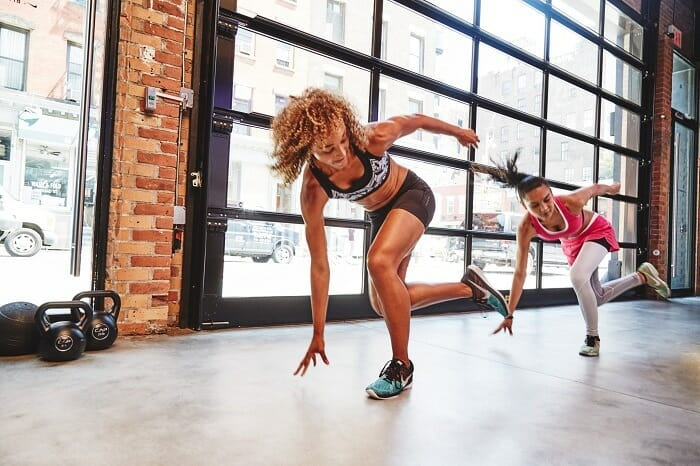 Woman in the middle of HIIT exercise