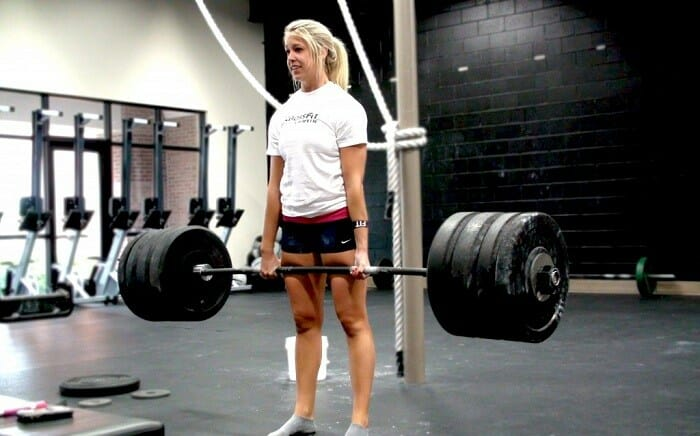 Woman lifting heavy weight