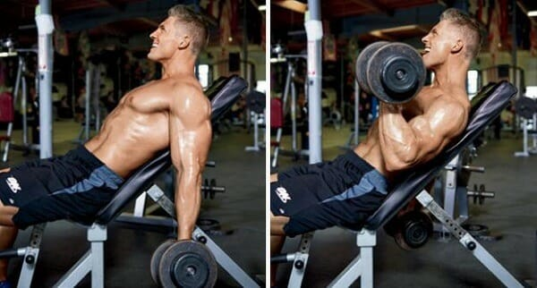 Man showing how to perform incline dumbbell curls