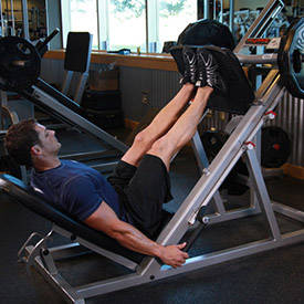Man showing how to perform leg press