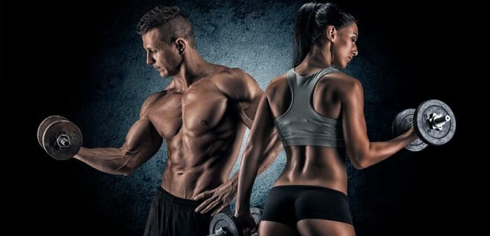 Attractive man and woman exercising at the gym