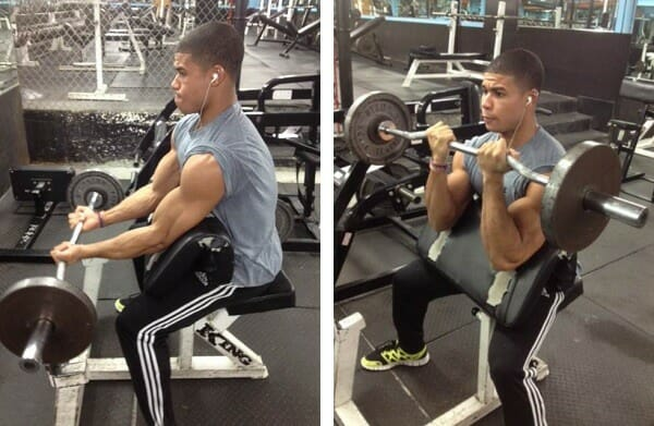 Man showing how to perform preacher curl