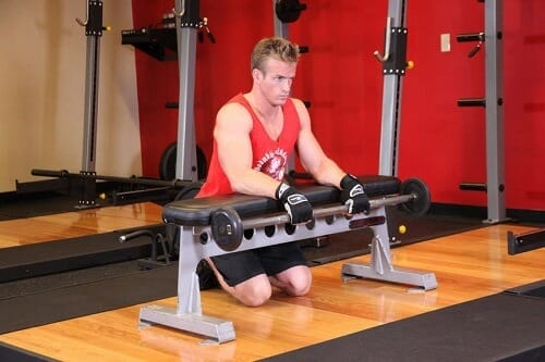 Man showing how to perform reverse wrist curl