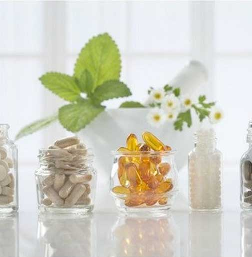 different weight loss supplements in bottles