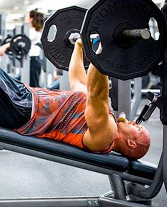 Man doing decline bench press workout