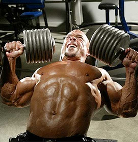 Man doing incline dumbbell chest workout