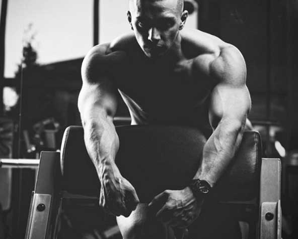 Man in a gym in black and white
