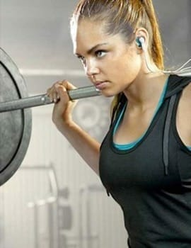 serious lady in lifting weights