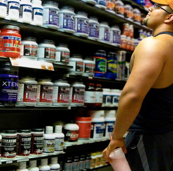 man shopping for supplements