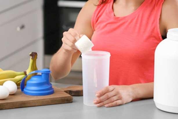 fit woman preparing bcaa shake