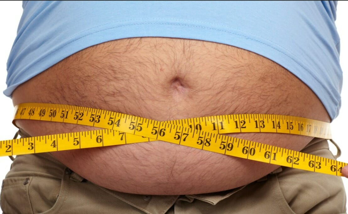 measuring fat tummy