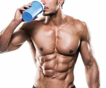 muscle buffed guy drinking protein shake