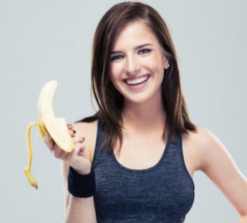pretty girl holding a banana