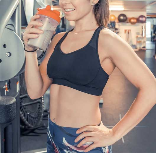 fit woman with lactose free protein shake