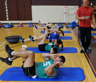 athletes doing bicycle crunches