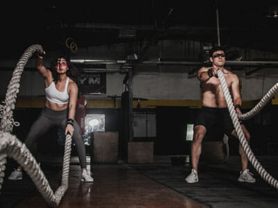 man and woman holding the ropes