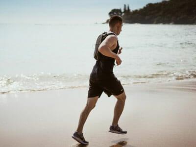 man wearing black running