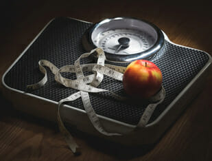 weighing scale, apple, and measuring tape
