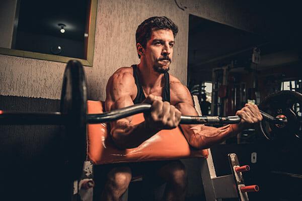 man bulking up in gym