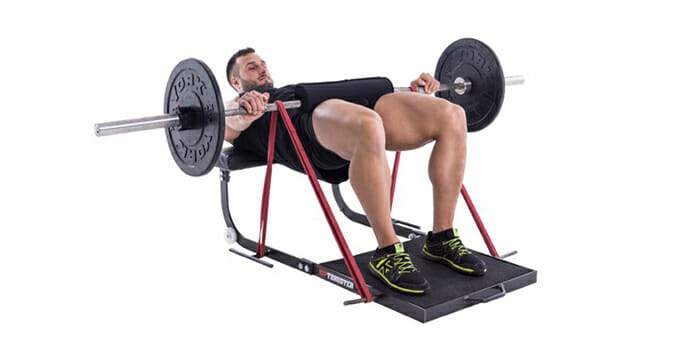 man-doing-barbell-bridge-exercise