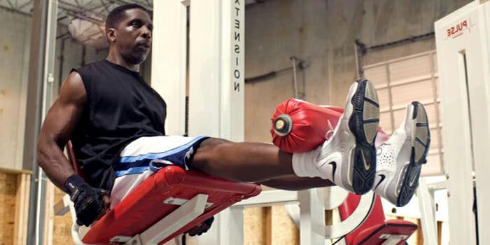 man-doing-leg-extentions-workout