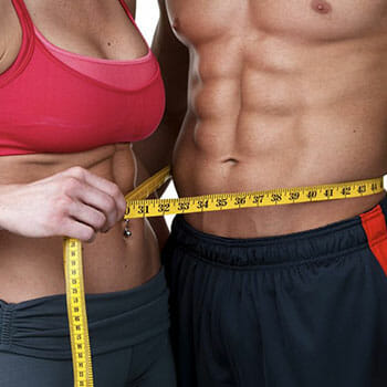 man and woman measuring waist line